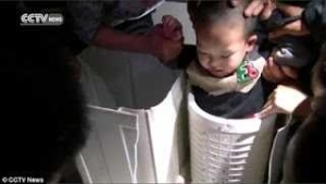 Little boy got rescued after getting stuck in a washing machine while playing. [Photos]